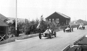 Cooper car on roof Blandford Camp Dorset motor racing
